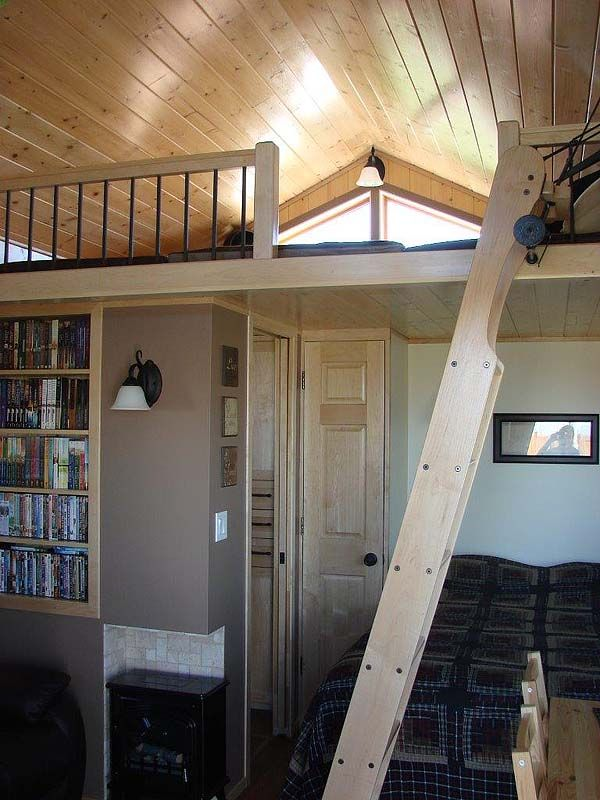 loft area and ladder -- There is also a loft that can sleep up to 3 people. My husband built a custom ladder that folds down for loft access and lifts back up into place – sitting horizontal with the loft – when not needed.