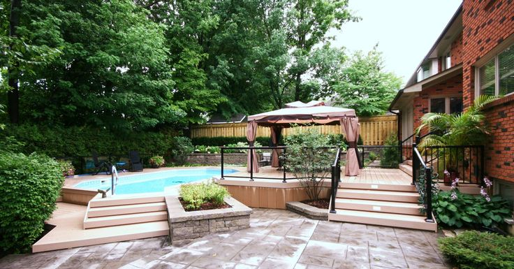 An onground pool deck built out of Azek decking in Ancaster, Ontario.