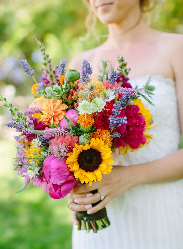 colorful bridal bouquet with sunflowers, poppy, larkspur, lavender, physostegia, dahlias, roses