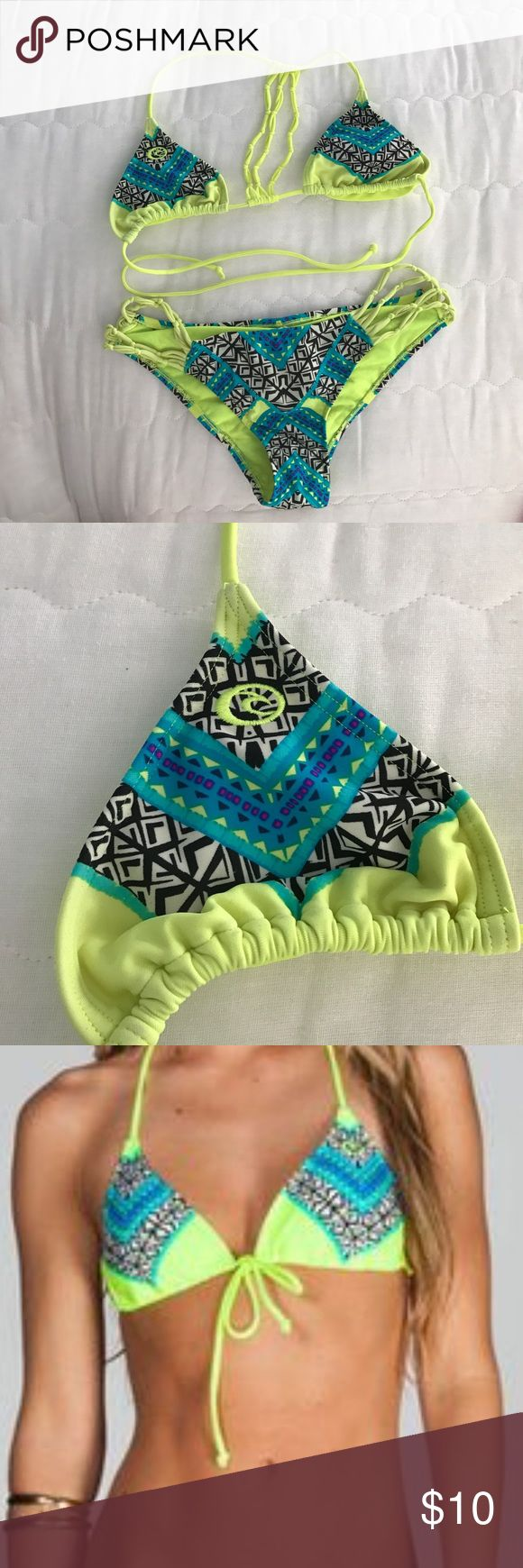 Rip curl triangle bikini top and bottom This bikini top ties in the front and the top and bottoms sport an Aztec mixed pattern with neon green, blue, purple, and black. Rip Curl Swim Bikinis