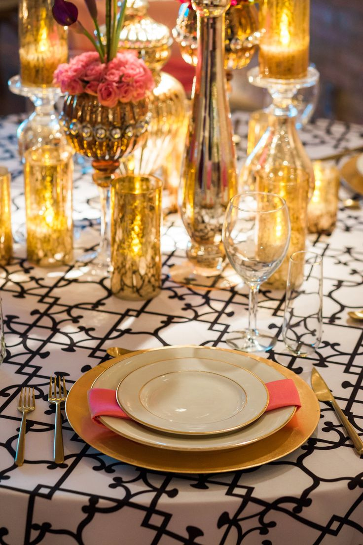 We are in love with this color theme. Black and White Versaille print with Gold table accents and bright pops of Peony through out <3