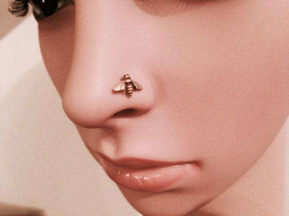 I made this sweet little nose stud from sterling silver and then plated it with rose gold. It measure 10mm across and will look most adorable in your nose!!  I can finish the back one of four ways which you can choose at check out. You can also choose what gauge you would like the post wire to be:  Gauge sizes: 18 gauge = 1.02mm 20 gauge = .812mm  Check out my other nose ring designs here: https://www.etsy.com/shop/DinanRings?section_id=14901831&ref&#x3D...
