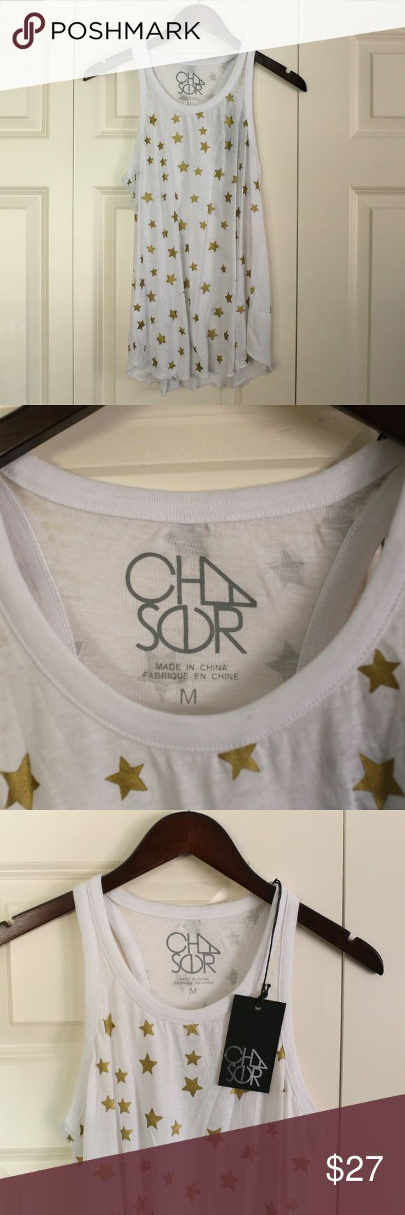 NWT CHASER Racer Back Tank with Gold Stars 📦 Ship out the same day or next, depending on when you ordered 💌 If you have any questions or would like to see more pictures, leave a comment! ❌No trades 🔎Color: White & Gold 🔎Style: Tank top 🔎Size: Medium 🔎Condition: New with tags, never worn Chaser Tops Tank Tops