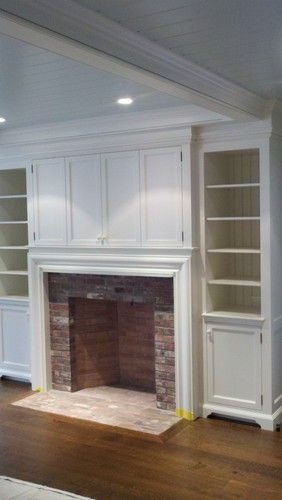 Fireplace millwork....custom bookcases and TV cabinet with bifold doors