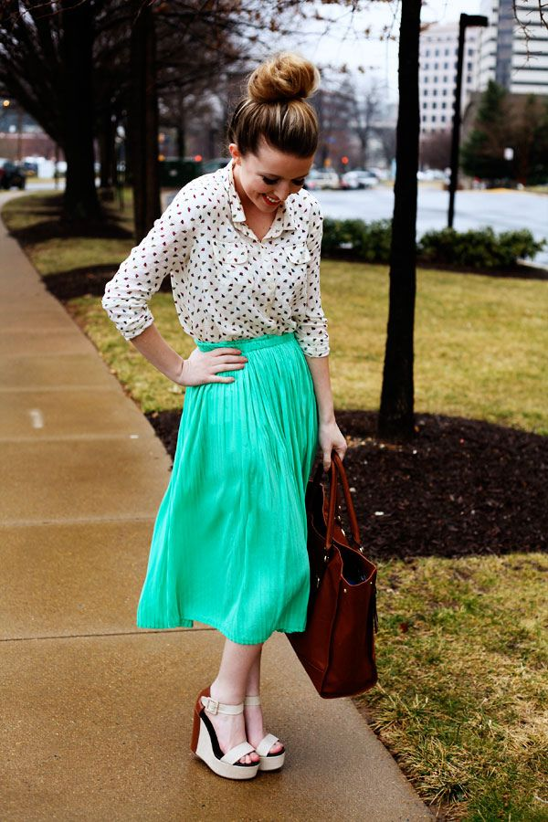 top knot, blouse, pleated skirt
