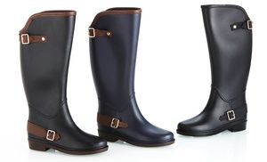 Water-resistant boots in classic riding style help keep your feet dry without sacrificing style