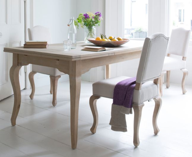 Our gorgeous classic French style Sunday chair is made by our skilled craftsmen. We love its weathered oak legs and natural linen fabric.