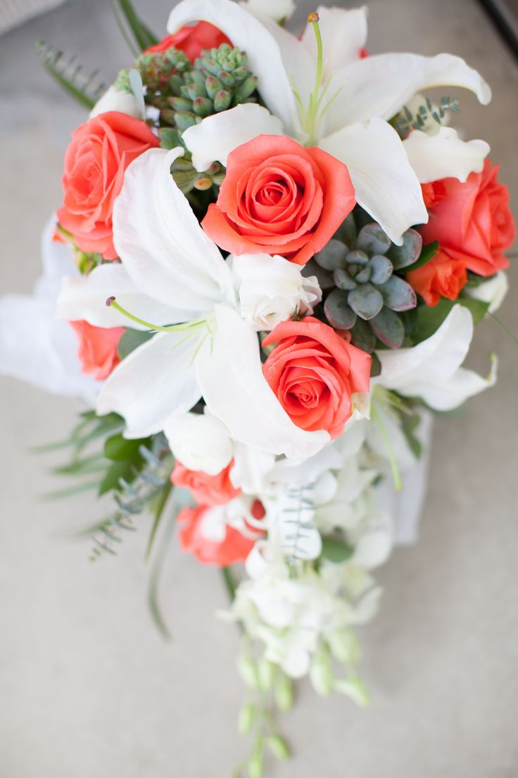 Coral cascade bride bouquet. White lilies, succulents, white orchids and beach greens.