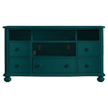 eye-catching media console, showcasing bun feet and a Belize teal hue.