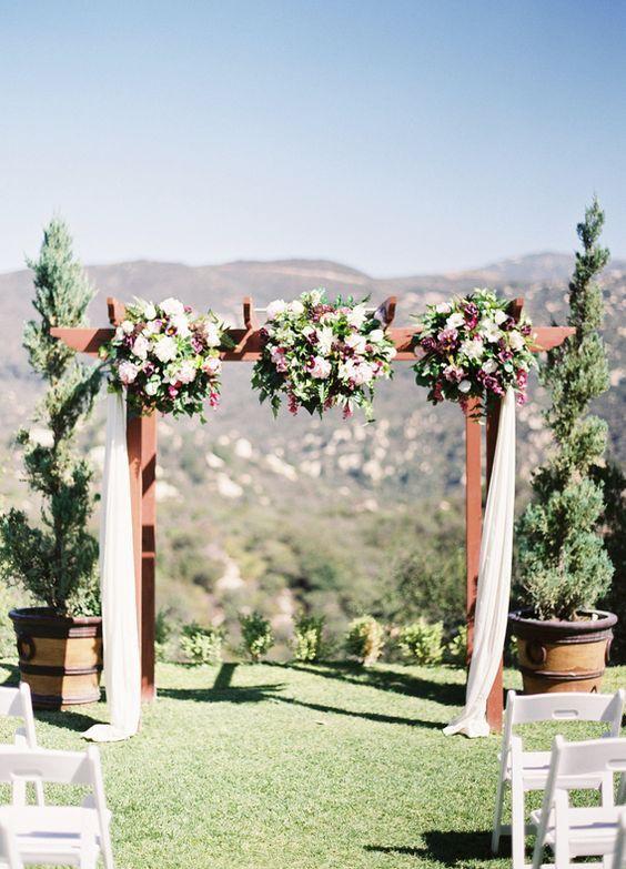 Chic outdoor wedding ceremony; Kurt Boomer Photo