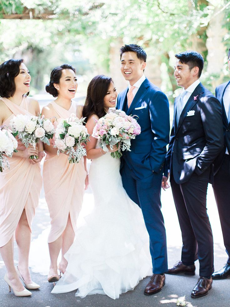 Peach and navy bridal party | We Are Origami | See more: http://theweddingplaybook.com/peach-navy-classic-waterfront-wedding/