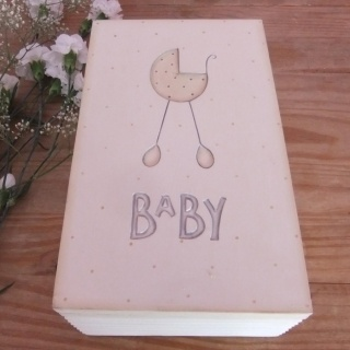 Wooden Baby Keepsake Box By East Of India £20.00    Large Wooden Baby Keepsake Box To Keep All Those Precious Memories Safe! A Vintage Pram & The Word 'Baby' Are Engraved On Lid. The Thick Wooden Lid Lifts On Hinges to Reveal A Cream painted Interior.    An Ideal Gift For Babies Birth or Christening and A Great Baby Shower Gift!    Handmade and Painted To give The Box A 'Shabby Chic' Feel.    29 x 18 x 10cm