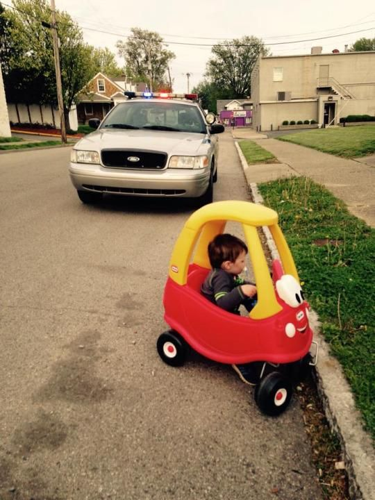 """Officer Bill Mayo pulled over Jaxon Arbuckle, 3, at his mother's request. Jaxon Arbuckle, Crawford's son, is a 3-year-old who loves his toy car. So when Crawford saw that a local Louisville, Ky., police officer was tending to a small car wreck on her street on Tuesday, she had an idea. """"I thought, 'How cute would it be if I got a picture of Jaxon pulled over?'"""" she tells Yahoo Parenting."""