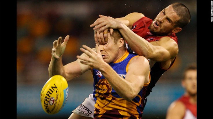 Ryan Harwood of the Brisbane Lions and James Magner of the