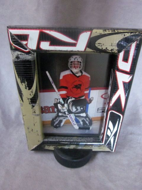 "Hockey Stick Picture Frame. I am going to do this with Waylon's first hockey stick and ""Little Penguins"" picture."