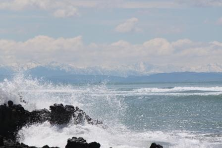 Sumner looking across to the Southern Alps, there is also a yacht race happening in there