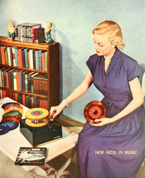 A woman playing RCA records, 1949. Music. Phonograph. Record player.