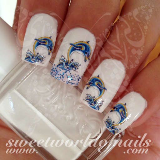 Dolphins Nail Art Nail Water Decals Water Slides 20 water decals (as in second picture) on a clear water transfer which can be applied over any color varnish on either your natural or false nail. Use:
