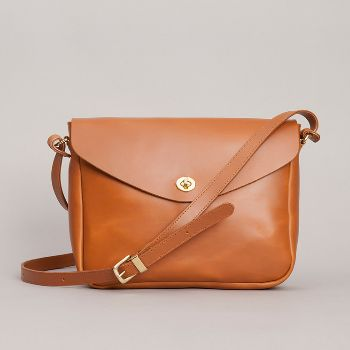 Tan Frank Leather Shoulder Bag: Tan medium shoulder bag made from the finest vegetable tanned leather.  Lined in beige cotton drill, with one interior zip pocket and and two patch pockets.  Exterior pocket on the back.  Brass turnlock fastening.  Long buckled strap 123cm.  Made in England.