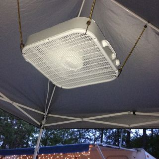 "Fan being held up with bungee cords to ceiling of tent...gives a new meaning to ""ceiling fan"""