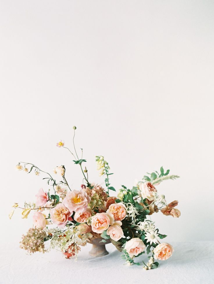 beautiful organic floral centerpiece in pastel hues