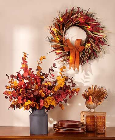 "This Natural Harvest Decor Collection features natural elements that work well for the fall season. The vibrantly colored Lighted Wreath (22"" dia.) is made of n"