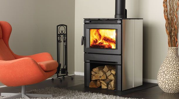 A wood stove with a modern look and stainless steel side panels.