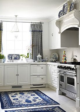Beautiful white and blue kitchen. Check out the over the stove!  Could I do something like that?