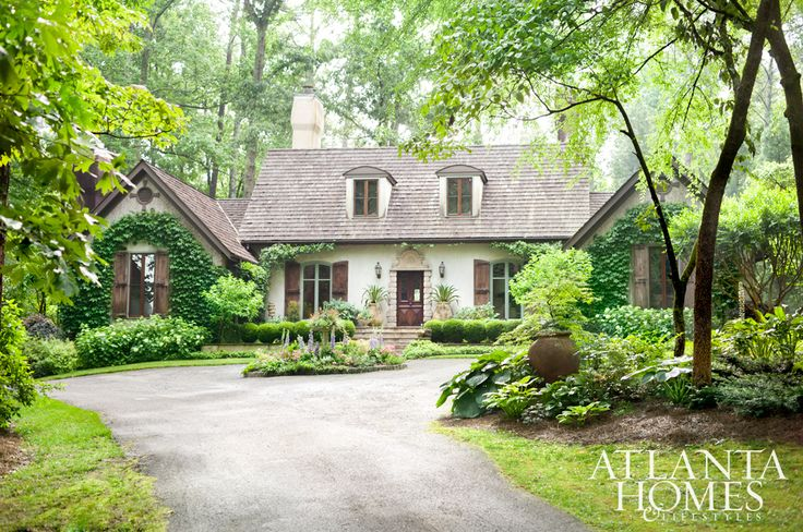 Located on 10 acres of land just outside Atlanta, this home's charming facade and gardens create a warm welcome.