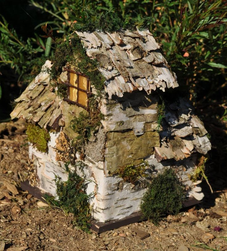 Natural materials; this fairy house is made with stone, bark, moss,