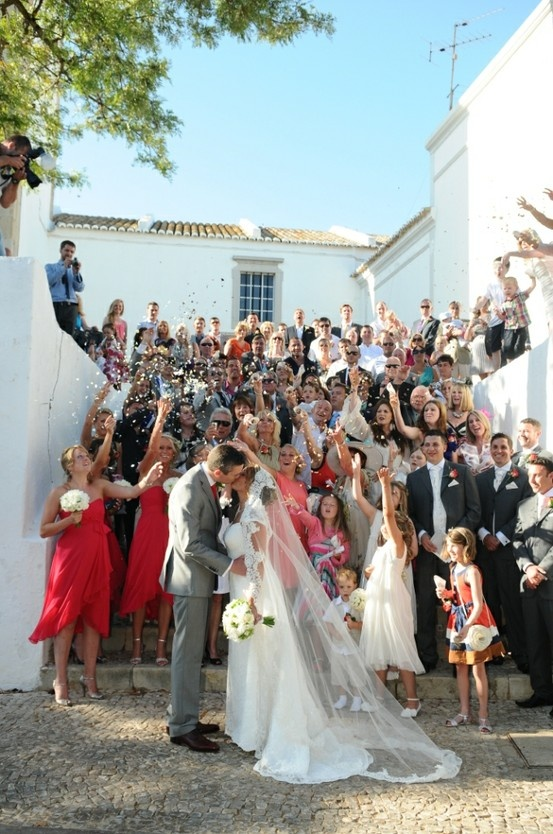 Wedding group photo rice throwing at St Bárbara Church Algarve Portugal by Algarve Wedding Planners