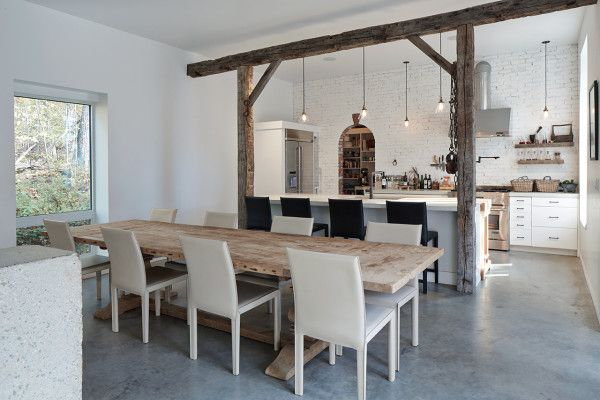 Love the beams and the painted bricks. The large farmhouse table doesn't hurt either. | Hebron House by Benjamin Oliver AD via @designmilk