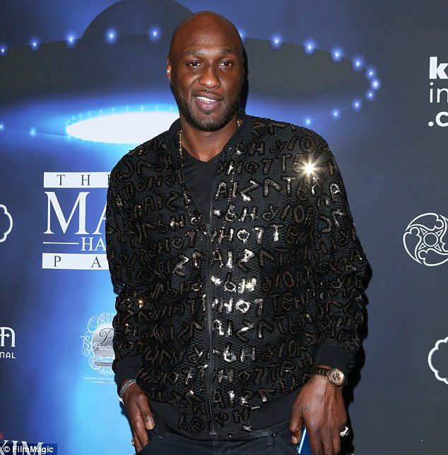 Partying: Lamar Odom, who almost died from a drugs and alcohol overdose two years ago, rang in the New Year at a club in the Dominican Republic where he was photographed downing beer and shots, TMZ reported on Monday. He's pictured in October in LA
