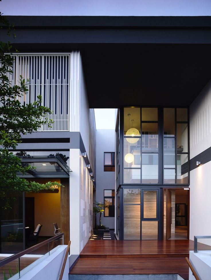 Main entrance of a private residence in Singapore by a-dlab