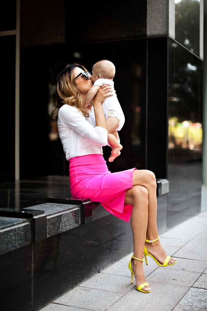Well hello, cutest mom ever! Don't know how she can walk steady in those stilettos but more power to her! Love the neon pink skirt. Makes business fashion fun. #dressbrightly