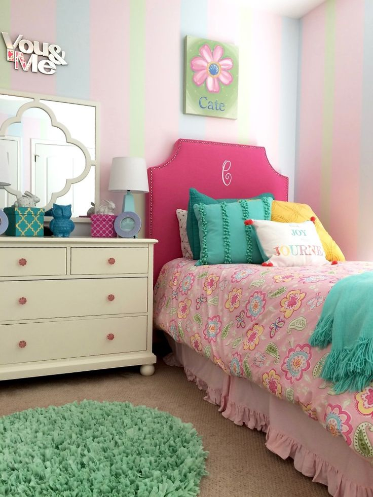 twin girls room makeover with upholstered monogramed headboards and floral bedding from pottery barn kids