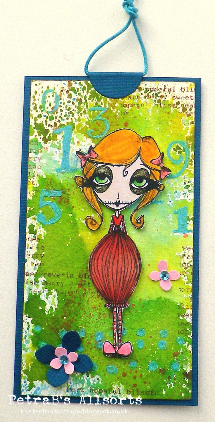 Quirky Cordillia. image: Dilly Bean coloured with distress markers - inky background (distress inks and water) - stencilling withe Fresco Paint, punched little flowers, bling, Bazzill Basic card