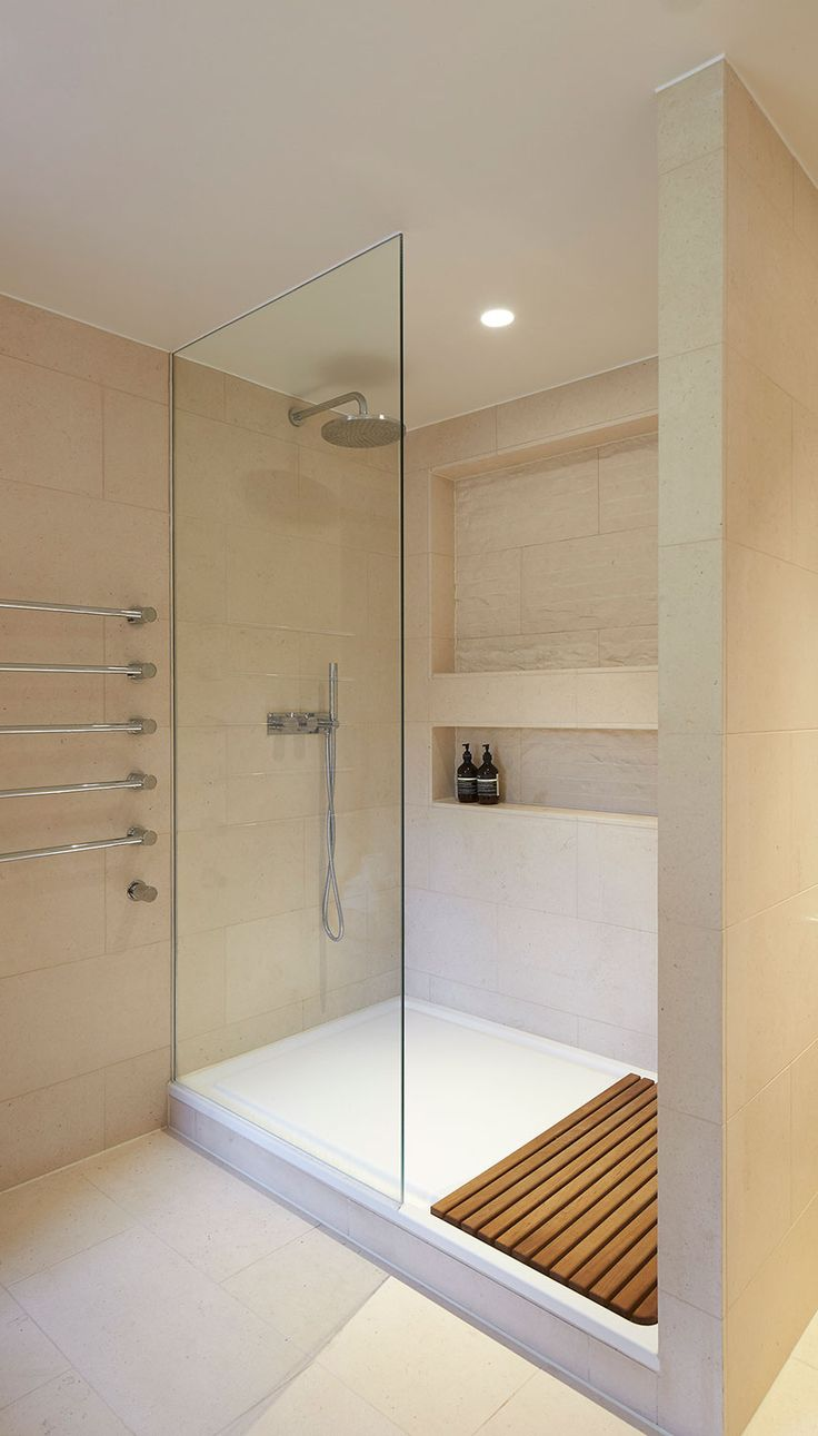 A super cool residential shower suite, fitted with natural stone wall and floor tiles from the Solar range. The double shower features a handy recessed shelf and a rainforest shower head.