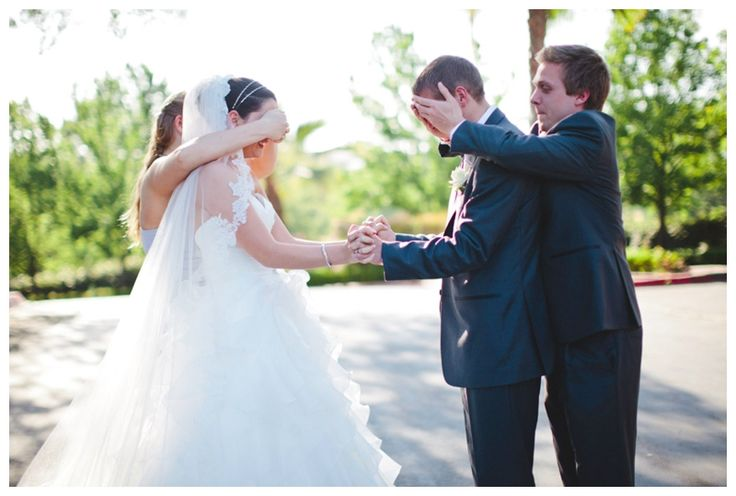 A photo before the wedding without seeing each other! Their eyes are covered by the maid of honor and best man :) © Katy Weaver Photography