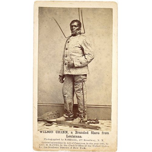 US Slave the demeaning collar around his neck was most likely because he was a runner ..making it harder to escape ..bells were often attached as well  so he could be heard where ever he was