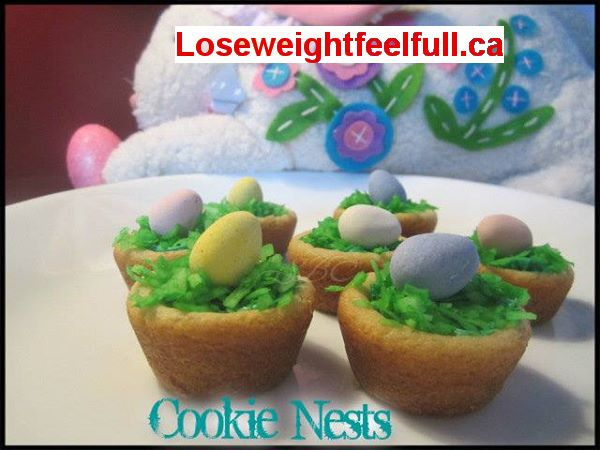 Cookie Nests  Use a small ziploc bag and place 1 pk shredded coconut inside adding color... 8 drops of green and 4 drops of yellow with a teaspoon of water and shake bag until all colored..set out to dry out a bit. Slice store bought  sugar cookie dough and half the slices and roll into a ball and place in un greased mini muffin tin and bake for 7-8 minutes. When cooled remove from tin and add a tiny bit of frosting to the top and push colored coconut into it and add chocolate egg.