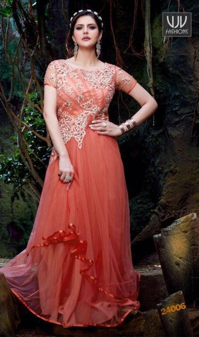 Zarine Khan Orange And Pink Georgette Anarkali Salwar Kameez Make the heads turn when you dress up in this charming Zarine Khan maroon georgette designer suit. This attire is showing some really mesmerizing and innovative patterns embroidered with embroidered and patch border work