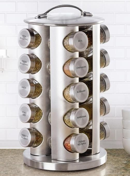 This Kamenstein stainless steel 20-jar revolving spice rack will make an attractive addition to your countertop. The space-saving carousel design spins to keep the right herb or spice at your fingertips. Slide-in slots hold the jars securely when rack is rotated. Each jar features a sifter disk for light seasoning that can be removed for pouring and easy measuring. The jar caps are clearly labeled for easy identification.