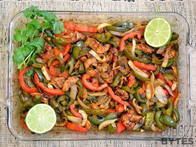 Oven Fajitas.... SEASONING 1 Tbsp chili powder, ½ Tbsp paprika, ½ tsp onion powder, ¼ tsp garlic powder, ¼ tsp cumin, ⅛ tsp cayenne pepper, 1 tsp sugar, ½ tsp salt, ½ Tbsp corn starch   FAJITAS 2 small (or 1 lg.) onion  2 medium green bell peppers  1 medium red bell pepper 1 lb. chicken breast 2 Tbsp vegetable oil 1 medium lime  8 (6-inch) tortillas ½ cup sour cream  ¼ bunch cilantro