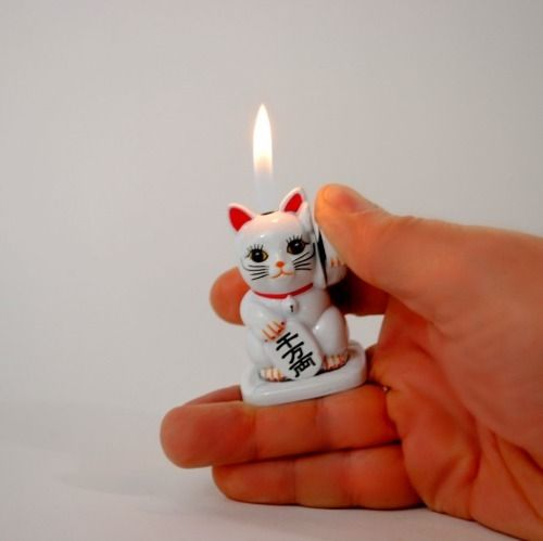 This is a bad-ass Maneki Neko lighter!  This weekend I go in for my tattoo to represent Jasper (tuxedo print & one-eye) and a maneki neko to match Lonny as he gets one too :)