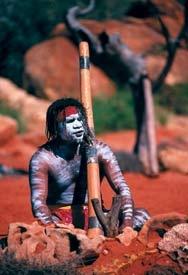 Ayers rock Uluru aboriginal man with a Didgeridoo.