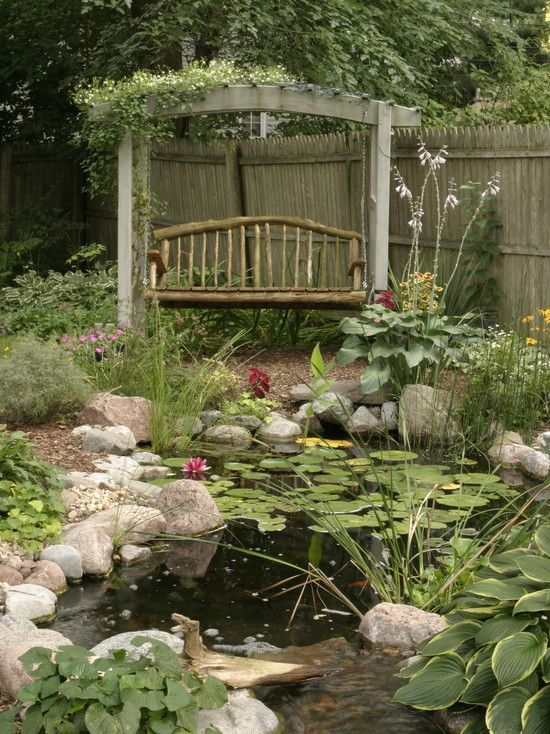 Nice Swing with view of small pond and nice variety of flowers and stones.