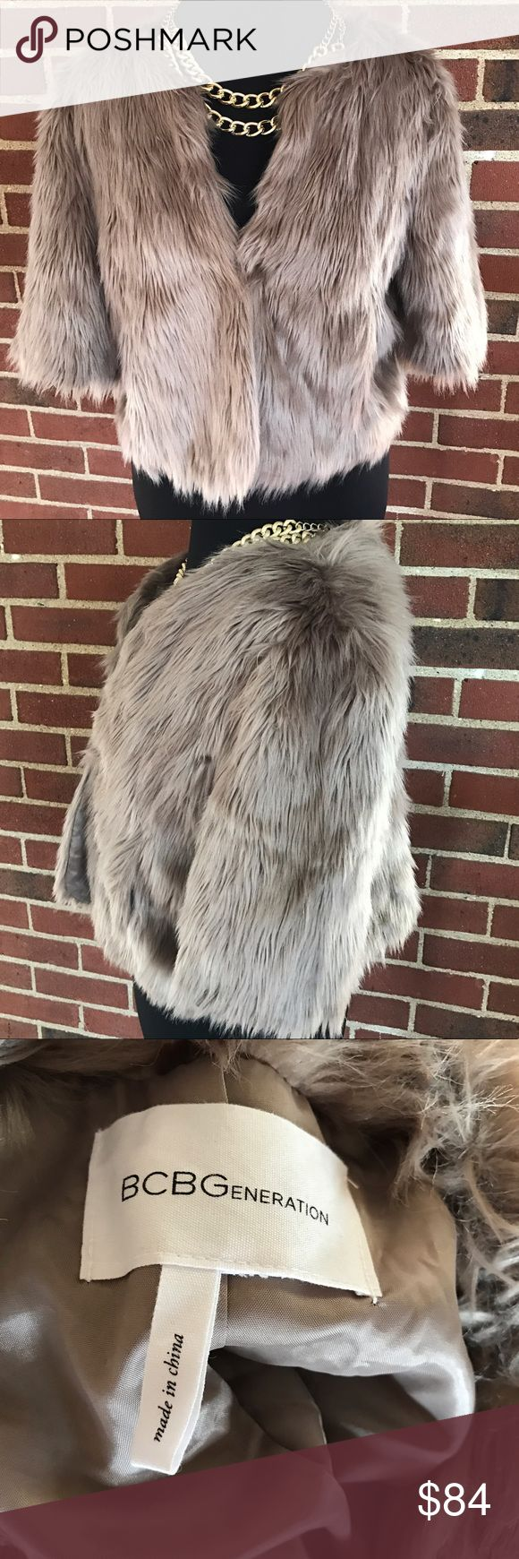 BCBGeneration Faux Fur Cropped Jacket Size Large. In like new condition, only worn once. Hook & eye closure in center of jacket. I love getting bundle offers, so please don't be shy❤️ Sorry, no trades. From a smoke free & pet free home. BCBGeneration Jackets & Coats