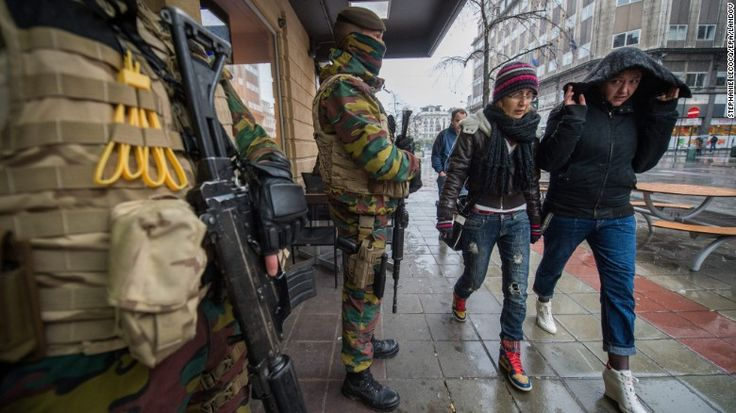 Armed military men stand guard in front of a restaurant in downtown Brussels, Belgium, 21 November 2015. Last night Belgium raised the alert status at Level 4/4 as 'serious and imminent' threat of an attack, the main effect are closing of all Metro Line in Brussels, all soccer match of league one and two cancelled countrywide. Belgium government said 'the advice for the population is to avoid places where a lot of people come together like shopping centres, concerts, events or pu...