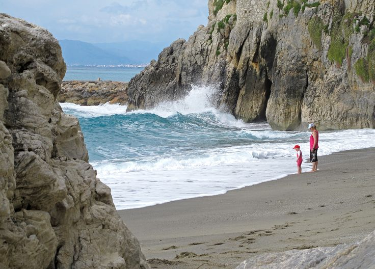 Watching the waves at Finale Ligure, Italy